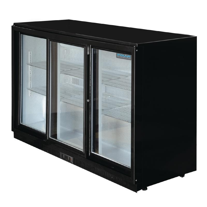 big pub fridge for bar area load with lots of bottles to chill